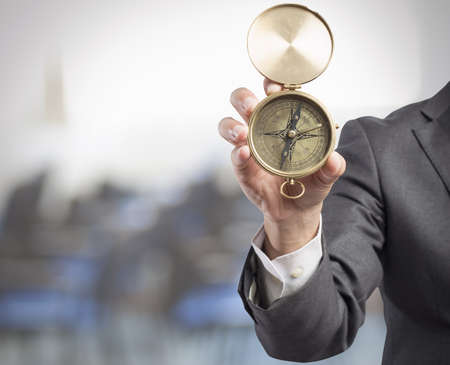 Concept of orientation in the business with businessman and compass