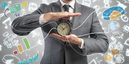 Concept of time is money with businessman and clock photo