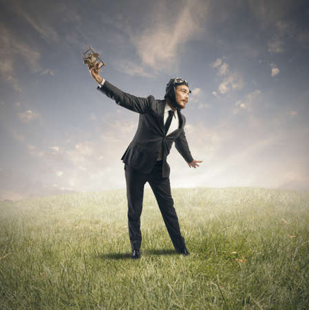 Concept of a businessman who dreams to flying photo
