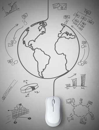 connected world: Concept of mouse connected with the world Stock Photo