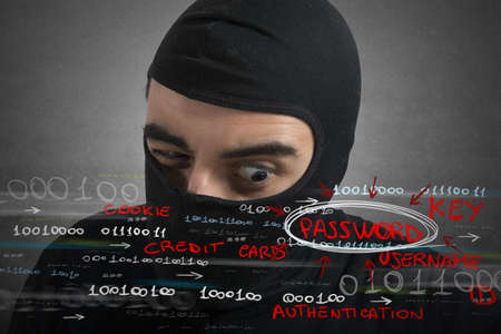 Hacker looking for password and user information Stock Photo - 22793379