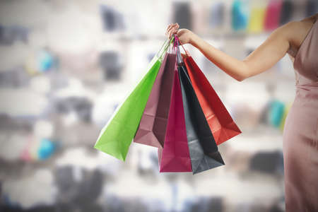 A woman holding several colorful shopping bags Stock Photo - 22806687