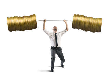 Concept of earning of a businessman who raises money as weights Reklamní fotografie