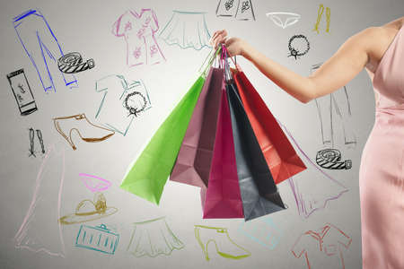 shopaholics: Shopping concept with several colorful shopping bags and drawing
