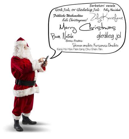 stupor: Pap� Noel con el mensaje de Feliz Navidad en varios idiomas Foto de archivo