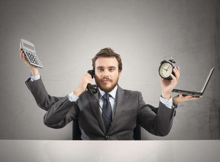 stressed businessman: Concept of multitasking businessman who works with more arms Stock Photo