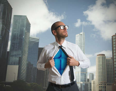 clouds: Businessman acting like a superman with blue torso Stock Photo