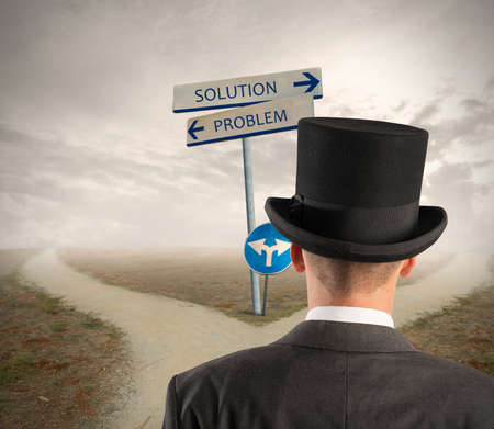 Businessman in front of a signal with problem and solution way