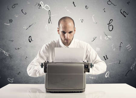 Businessman working with an old typewriter Stock Photo - 23050172