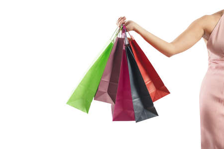 A woman holding several colorful shopping bags Banco de Imagens