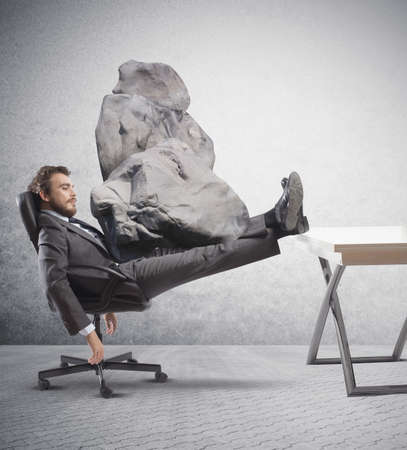 oppressed: Concept of stress at work with businessman crashed Stock Photo