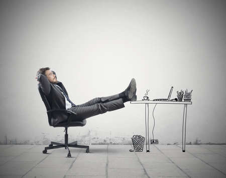 Successful businessman relaxing in an imaginary office Stock Photo - 23371777