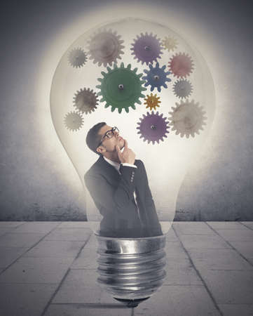 Businessman thinking about new idea inside a lamp Stock Photo - 23373220