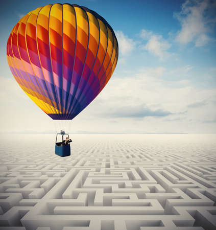 Concept of overcome obstacles with   businessman on a hot air balloon