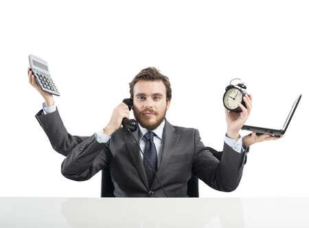 trabajos: Concepto de hombre de negocios multitarea que trabaja con m�s armas Foto de archivo