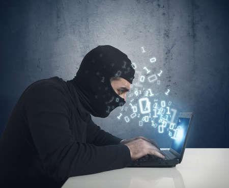 internet fraud: Hacker at work with a laptop and binary number