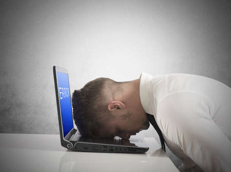 solve problems: Businessman with blue screen of laptop error