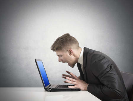disappointed: Businessman with blue screen of laptop error