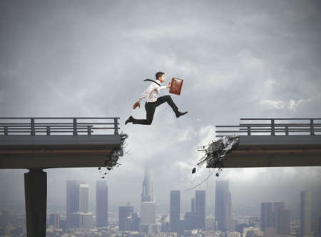 gaps: Businessman solves the problem of a broken bridge Stock Photo