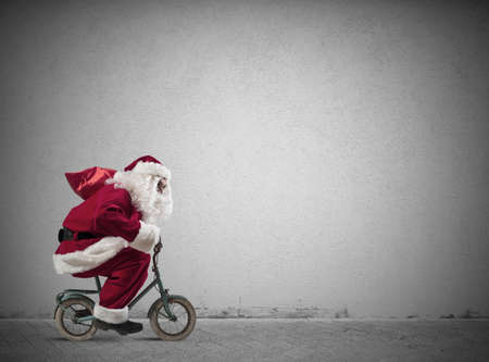 december: Fast Santa Claus on a small bike