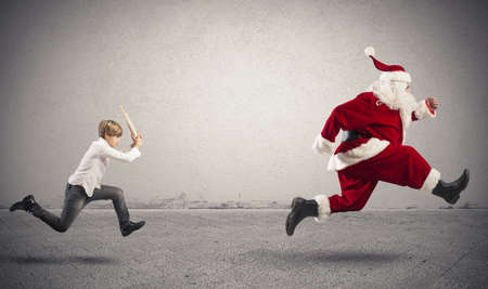 Angry child with Santa Claus for a gift wrong photo