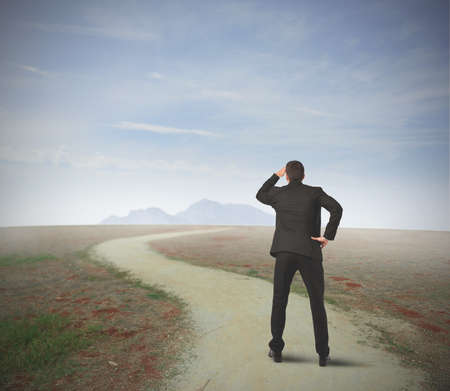 intent: Businessman in front of long way to the career