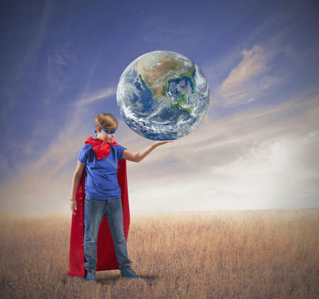 Concept of save the world with young hero Stock Photo - 23727876