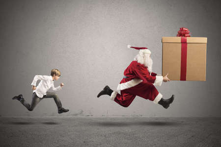 winter escape: Young boy wants a present from Santa Claus Stock Photo