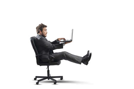 easy chair: Concept of fast business with businessman on the road Stock Photo