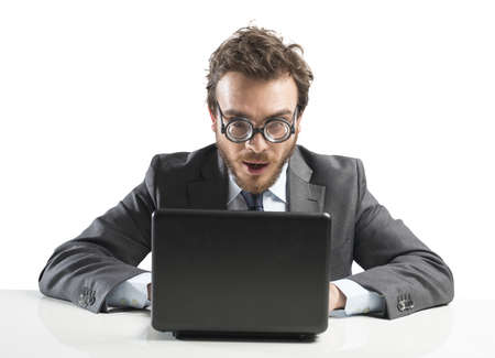 Nerd businessman working with a laptop on a desk Stock Photo - 23905588