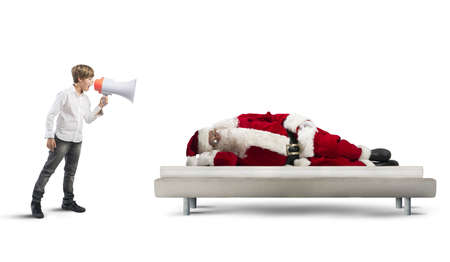 child in bed: A child wake up asleep Santa Claus Stock Photo
