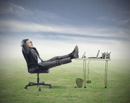 Successful businessman relaxing in an imaginary office