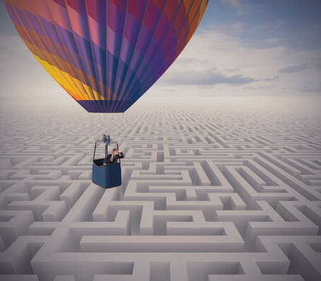 vision problems: Concept of overcome obstacles with  businessman on a hot air balloon Stock Photo