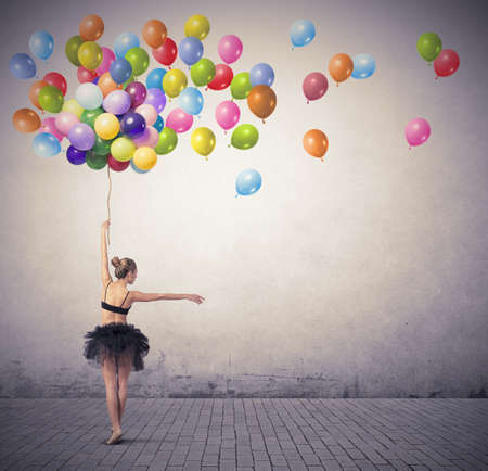 dancing pose: A beautiful girl dancing with colorful balloon Stock Photo