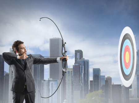 Concept of determination in business with bow and arrow photo