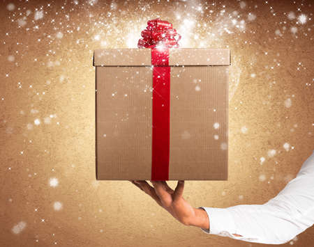 Gift with red ribbon with magic star effect Stock Photo - 24197168