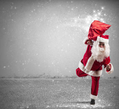 fast delivery: Running Santa Claus with sack full of magic gifts