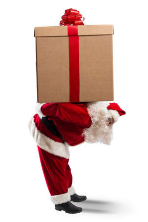 hard way: Concept of Santa Claus with a big gift Stock Photo