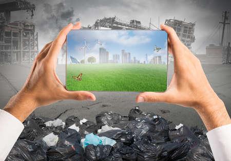 태블릿의 녹색 비전과 지속 가능한 개발의 개념 스톡 콘텐츠