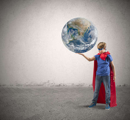 save the earth: Concept of save the world with young super hero Stock Photo