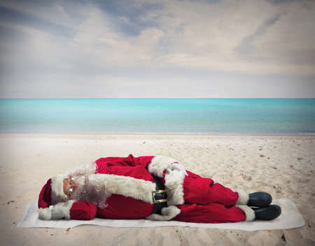 Santa Claus sleeping at the hot beach