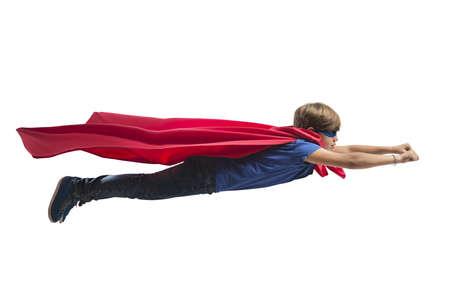 heroes: Superhero kid flying fast over the city