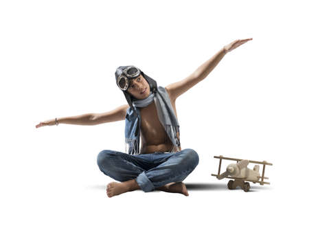 Young boy playing with toy airplane on white background Stock Photo - 24369281
