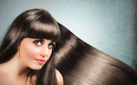 Long shiny hair of a beautiful brunette woman photo