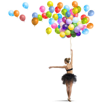 rainbow: A beautiful girl dancing with colorful balloon Stock Photo