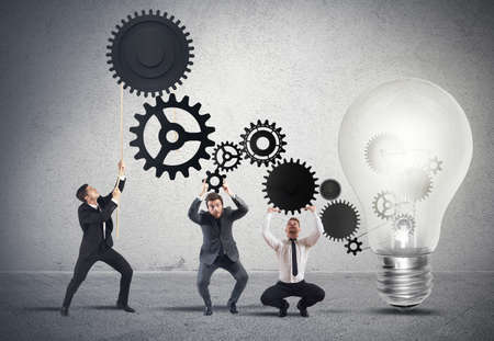 light transmission: Teamwork powering an idea with gear system Stock Photo