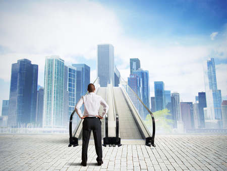 highrise: Businessman in front of a stairs to success Stock Photo