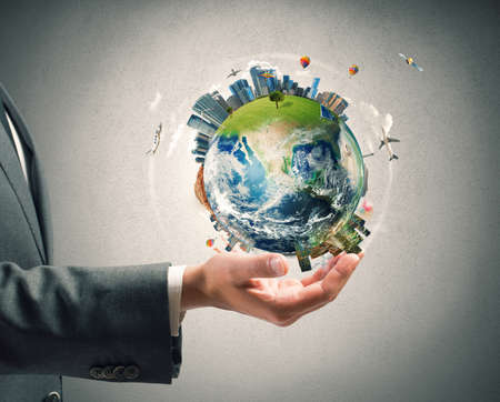 world: Concept d'énergie de l'entreprise. Homme d'affaires détient monde moderne