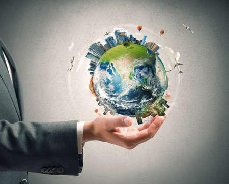 planeten: Konzept der Business-Macht. Geschäftsmann hält moderne Welt Lizenzfreie Bilder