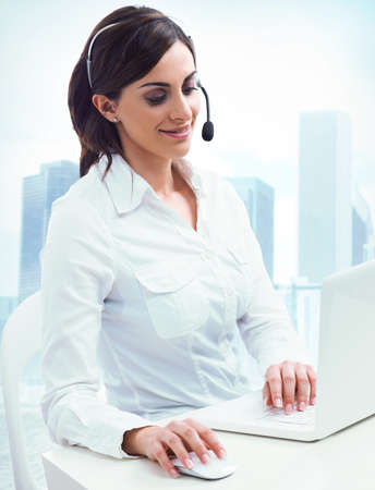 highrise: Concept of customer service  with beautiful woman  on call center Stock Photo